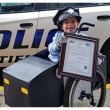 Nehemiah Hill transformed his wheelchair into a police cruiser and was even in uniform. (Credit: Tiffin Police Department)