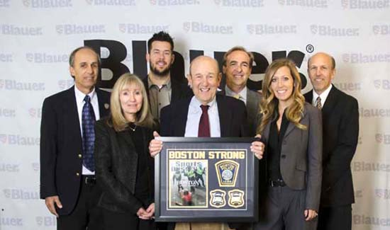 The Blauer team: Left to right: Michael Blauer, Sharyn Proia, Adam Blauer, Charles Blauer (holding plaque) Billy Blauer (behind Charles), Ali Blauer, and Stephen Blauer (on the end).