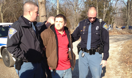Jaimi Luke Smith being escorted by Trooper Ryan White (right) and Sergeant Greg Day (left). Sergeant Doug Hutchinson behind Smith. (Photo: Nixle.com)