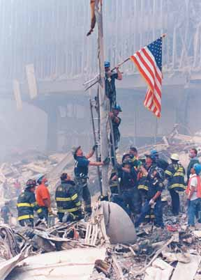 Miller raises the first American flag at Ground Zero the day after the terrorist attacks of Sept. 11.