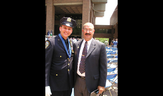 John Busching (left) with John McLoughlin on June 16, 2004 at Medal Day at NYPD Headquarters. McLoughlin, a former Port Authority police officer, was the last person to be rescued alive from the rubble at Ground Zero. Busching was one of the people credited with saving McLoughlin's life.