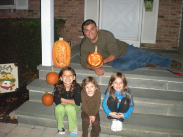 Mike Morra and his three daughters on Halloween night, 2008. Left to right: Marina, Lianna and Michaela. All the girls are showing a keen interest in sports.