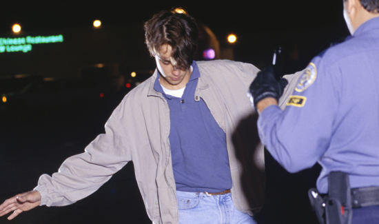 Teenage driver (16-17) taking sobriety test by side of road