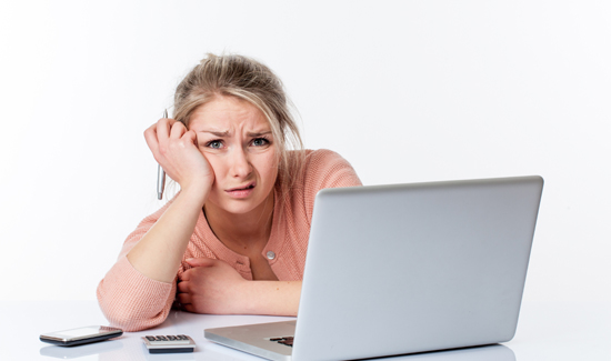 unhappy young woman working hard, looking disgusted and scared
