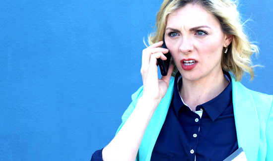 Serious stressed woman talking on phone