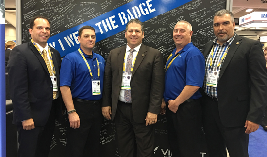 "Vigilant Solutions makes sure it has a lot of subject matter expertise in the form of former police officers working for the company. Left to right: Det. David Rivera, NYPD; Scott Dye, Oregon Department of Public Standards & Training; Lt. Tom Joyce, NYPD; Lt. Kevin Schneider, Hackensack, New Jersey; Det. Roger Rodriguez, NYPD. Everyone at Vigilant was involved in the ""Why I Wear the Badge"" tribute project and could not be prouder."