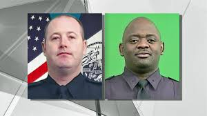 Sgt. Paul Tuozzolo, left, was killed by a heavily armed gunman responding to a home invasion. Sgt. Emmanuel Kwo, on right, was shot in the leg in the same incident.