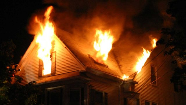 Heroic officer rescues homeowner and pet from house fire