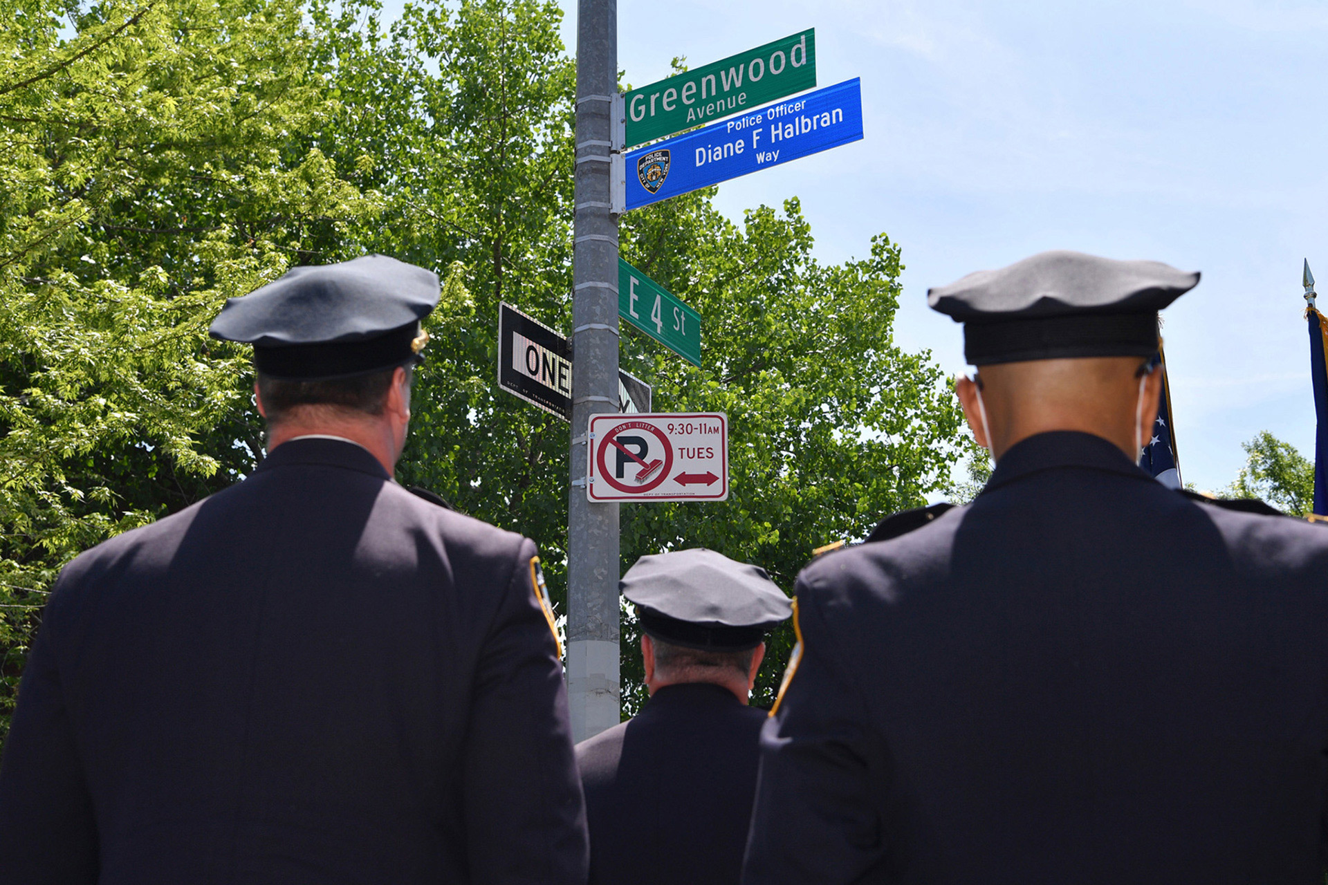 diane-halbran-street-renaming-3-Police-stand-near-the-sign-during-the-street-renaming-ceremony