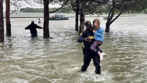 Officer rescues family trapped in flooded car