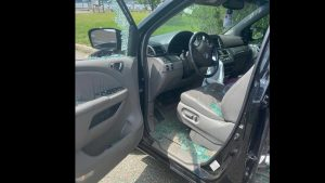 New Jersey police officer shatters window to save child stuck in hot car; offers to pay for the damage