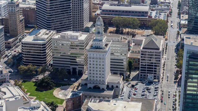 Oakland City Council cuts police budget by $18 million to reallocate to violence prevention programs; draws criticism from police chief