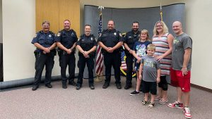 Oshkosh police officers react quickly to rescue family from house fire
