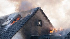 Officer rescues three people from house fire sparked by lightning strike