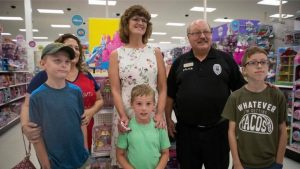 Police officers take kids back-to-school shopping