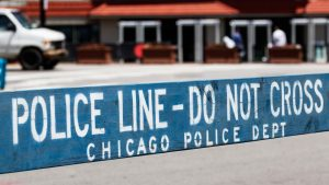 Chicago police officer wounded after the city is rocked by shootings that leave 14 wounded and two dead